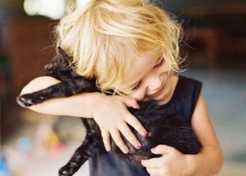 Фото, доказывающее, что дети должны иметь животных